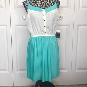 New with tags dress.  Teal and cream.